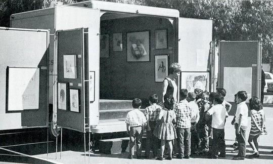 _lecturer-driver_welcomes_kindergarten_children_to_southern_california_s_artmobile.__from_early_childhood_art_by_barbara_herberholz__wm._c._brown_co.__dubuque__1974_